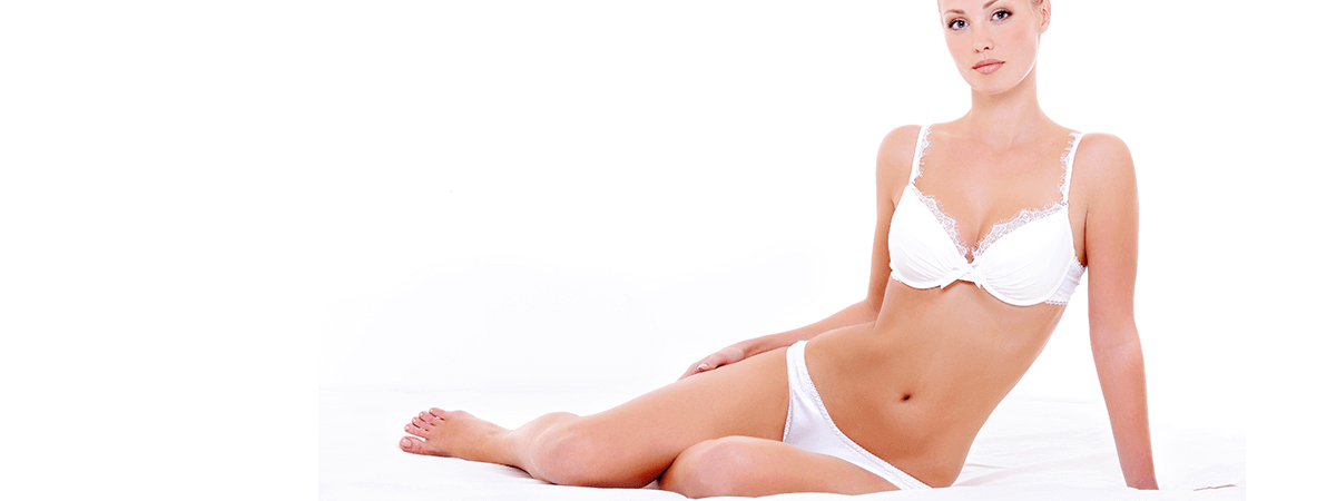 woman after liposuction in white bra and underwear sitting on side on white background