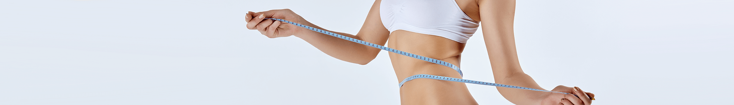 woman in white bra and underwear with tape measure wrapped around body