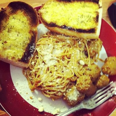 Spaghetti with spicy italian sausage and garlic bread