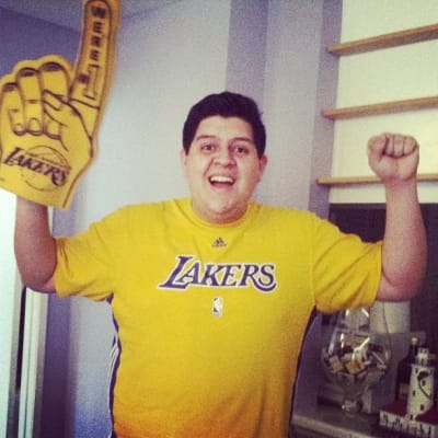 Me wearing a Lakers shirt and a foam finger