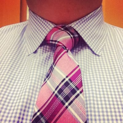 Pink and blue tie with a checkered shirt
