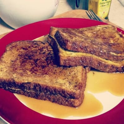 French toast with syrup drizzled over it