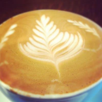 Latte art in form of a leaf