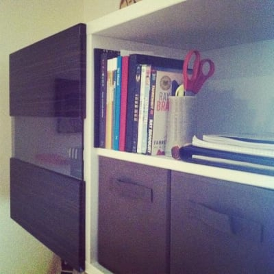 IKEA shelf with books and other supplies