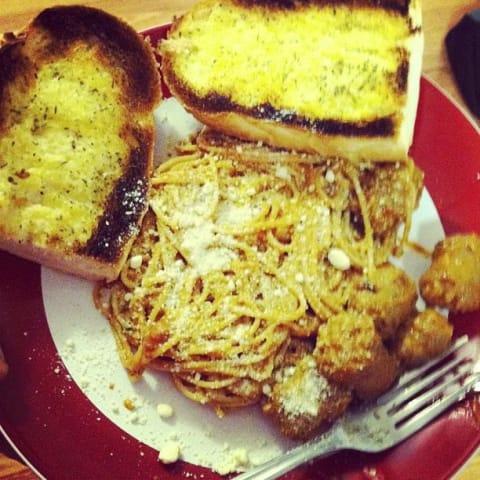 Spaghetti with spicy italian sausage and garlic bread