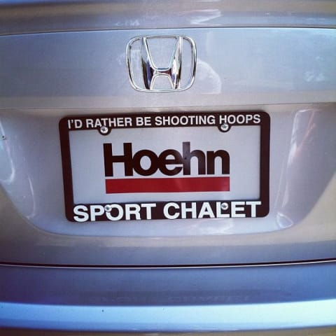 "License plate frame that reads ""I'd rather be shooting hoops"""