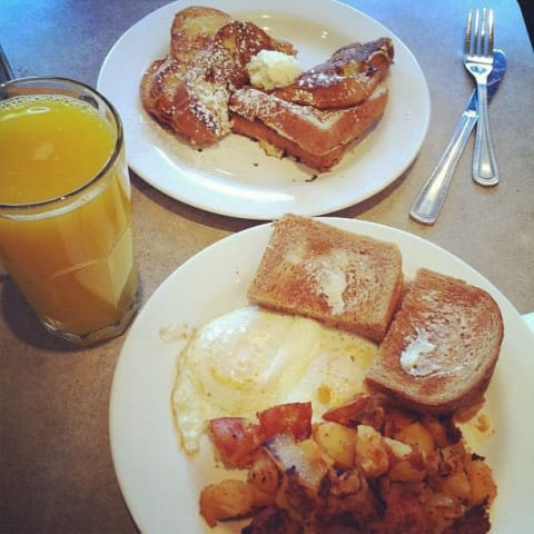 My breakfast includes eggs, potatoes, and french toast.