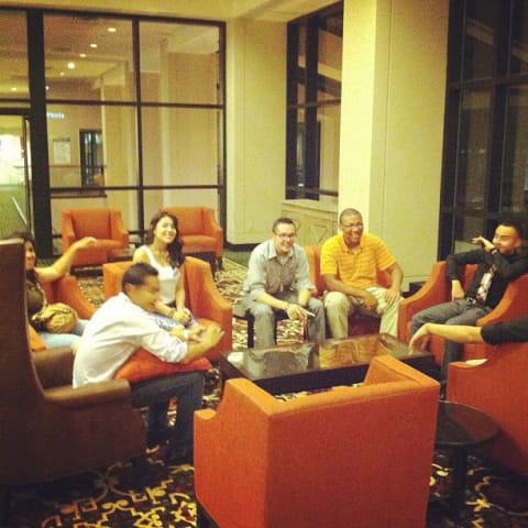 Friends seated in comfy chairs in a circle