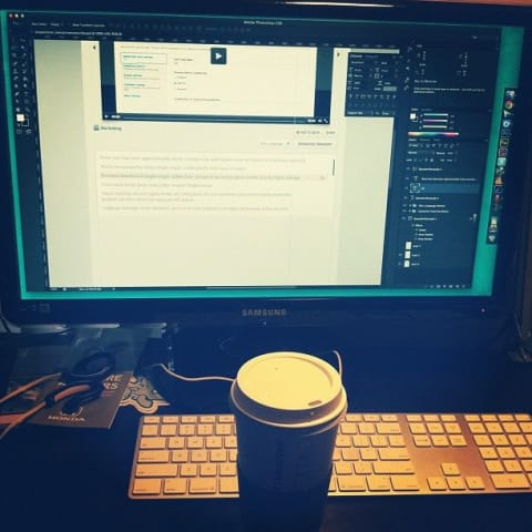 My coffee and keyboard are in the foreground with Photoshop on my display in the background
