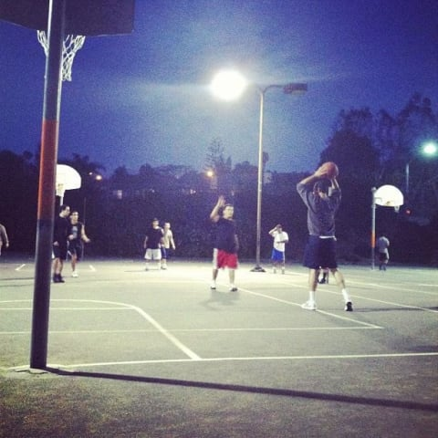 People play basketball at the local park