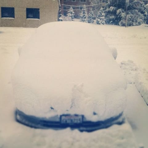 My car covered in a few feet of snow