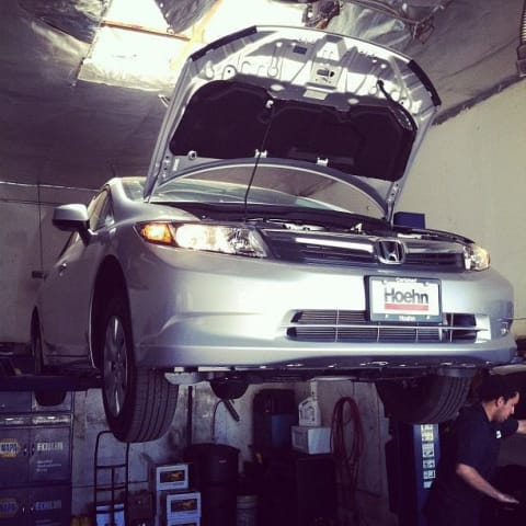 My Civic being elevated to change the oil