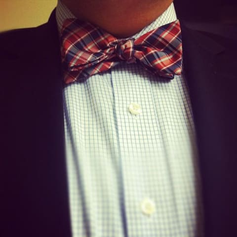 Me with a checkered shirt and bow tie