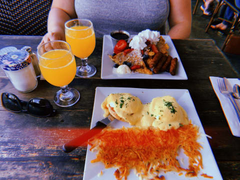 Table full with our breakfast and mimosas
