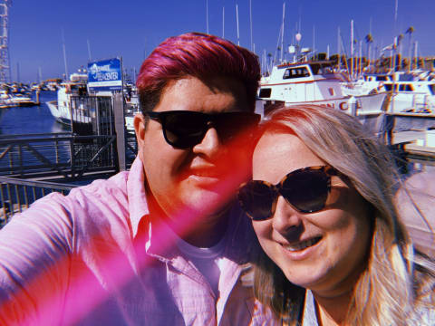 Kelly and I wearing shades with the docks in the background