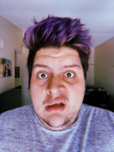 Selfie of me with a shocked look and long deep purple hair