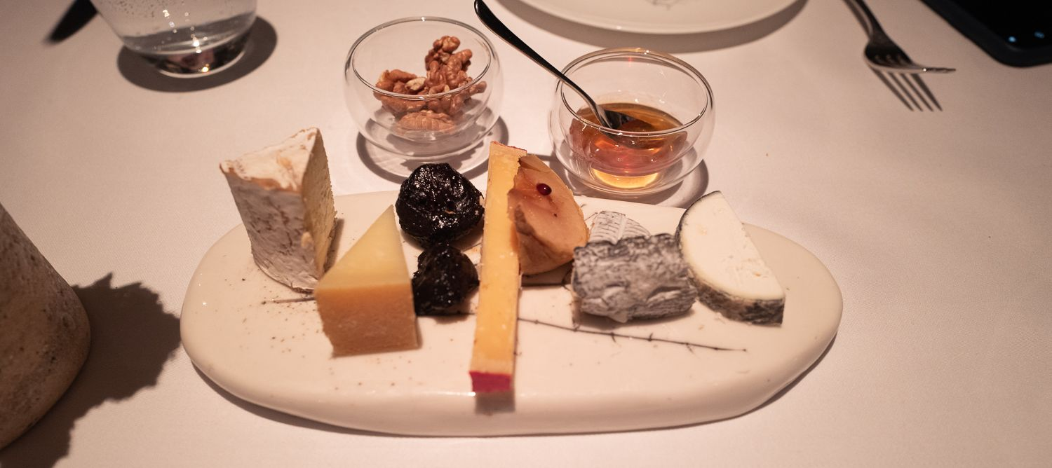 A mix of hard and soft cheeses paired with prunes, walnuts, and honey