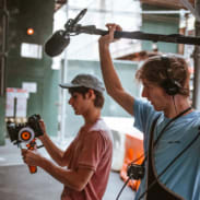 Film students using a camera and sound kit
