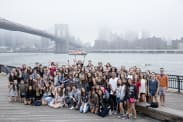camp group in front of Brooklyn Bridge
