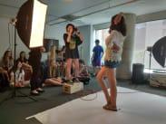 Photographers in class taking actor headshots