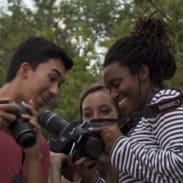youth photographers looking at camera