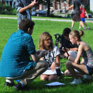 film students collaborating on set