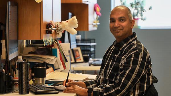 Dr. Shamal Wijay at his workstation