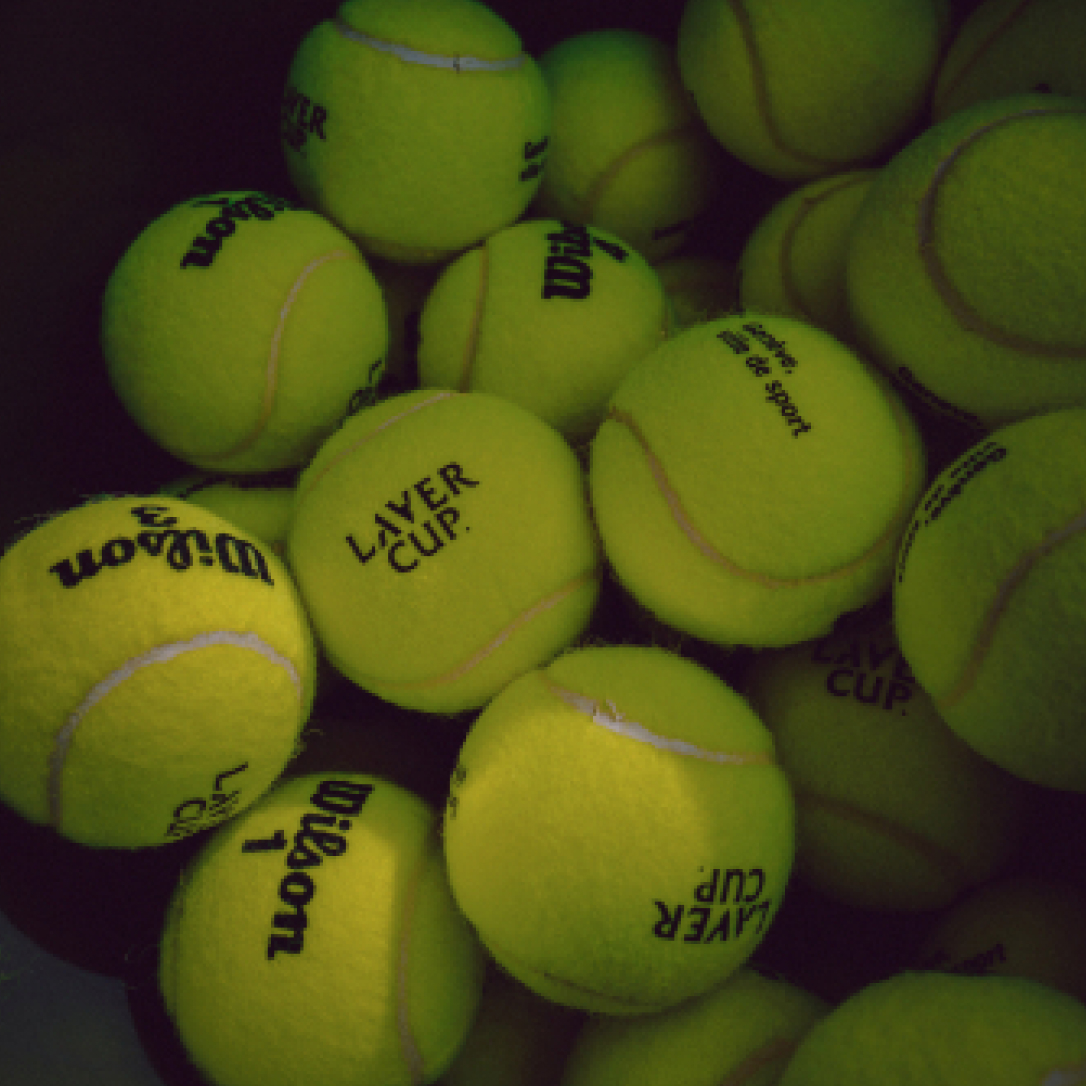 A large amount of green tennis balls.