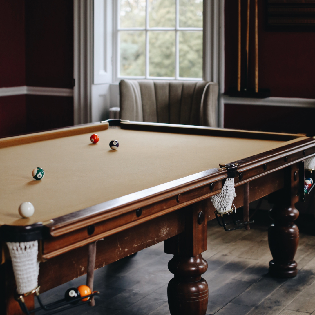 An interior space with a pool table.