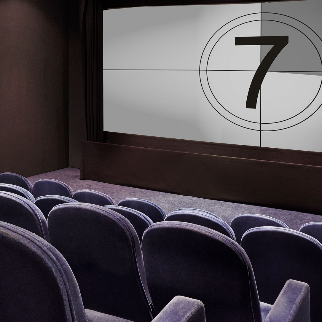 Cinema seating and a screen.
