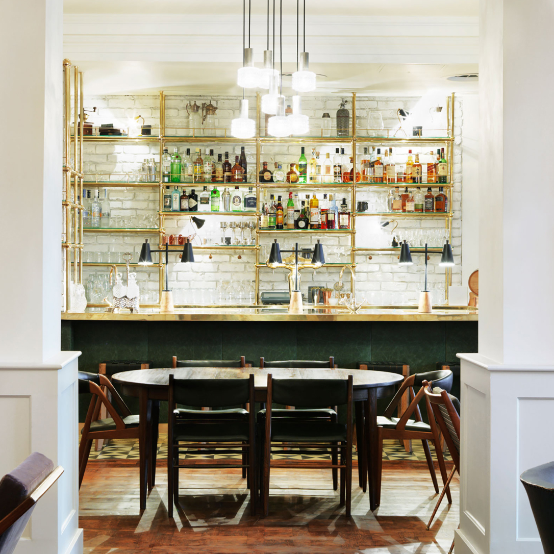 A bar in a white room.