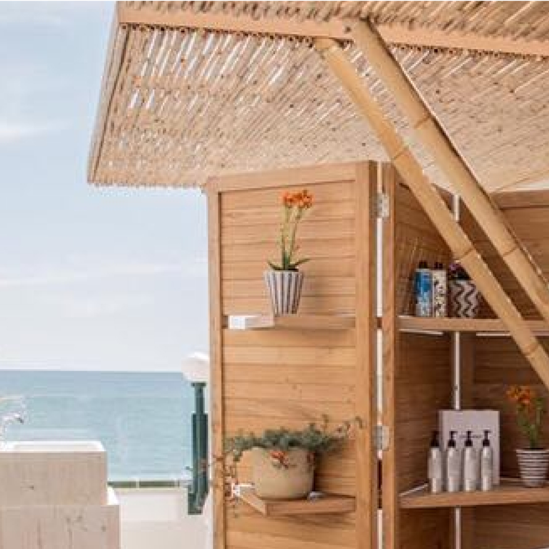 A wooden enclosure with beauty products and plants.
