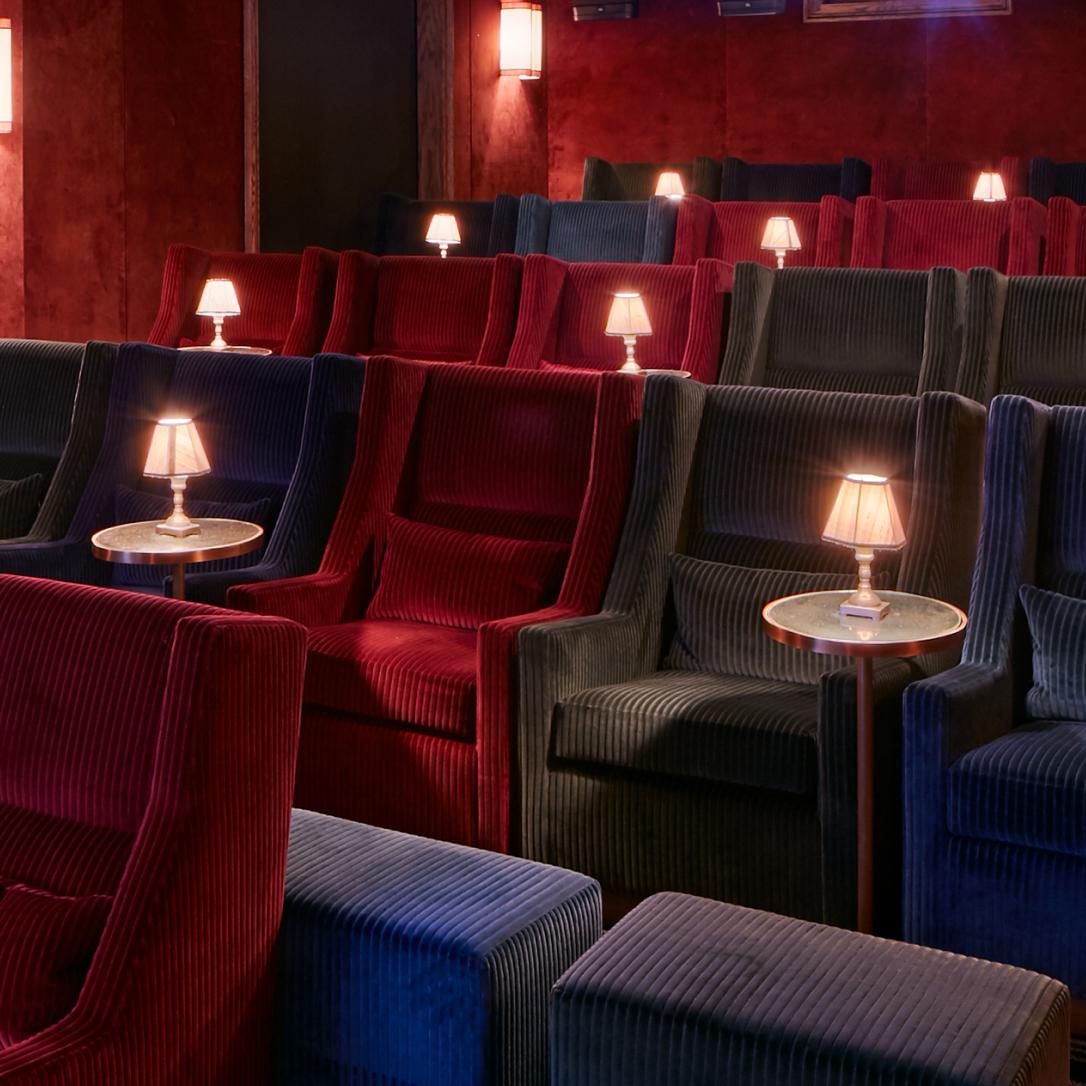 Rows of multicoloured cinema seats.