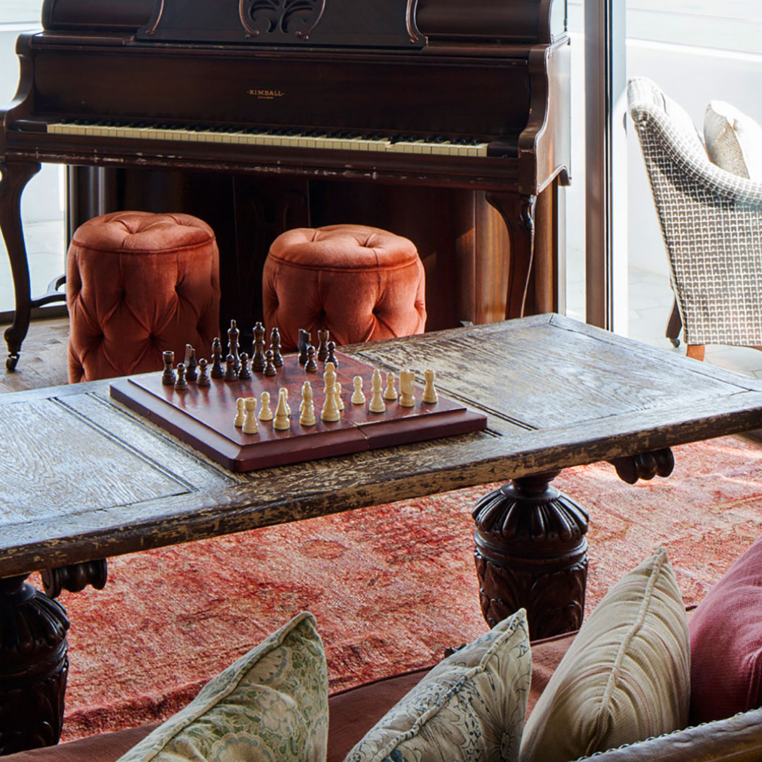 A chess board on a coffee table in an interior.