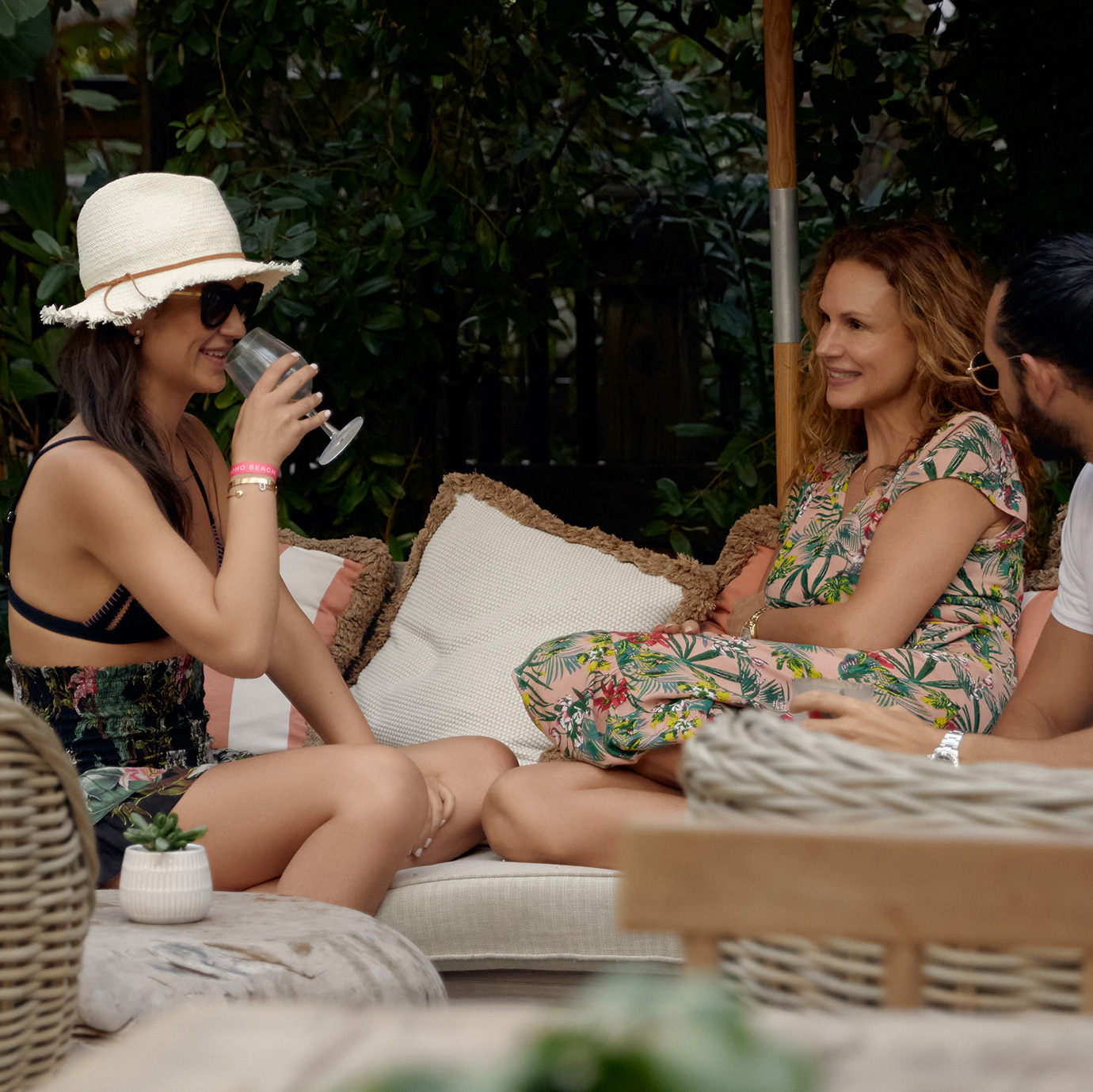 A group of women chating in an outdoor bar.