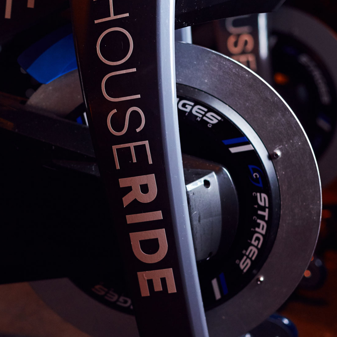 The front wheel of a spin exercise bike.