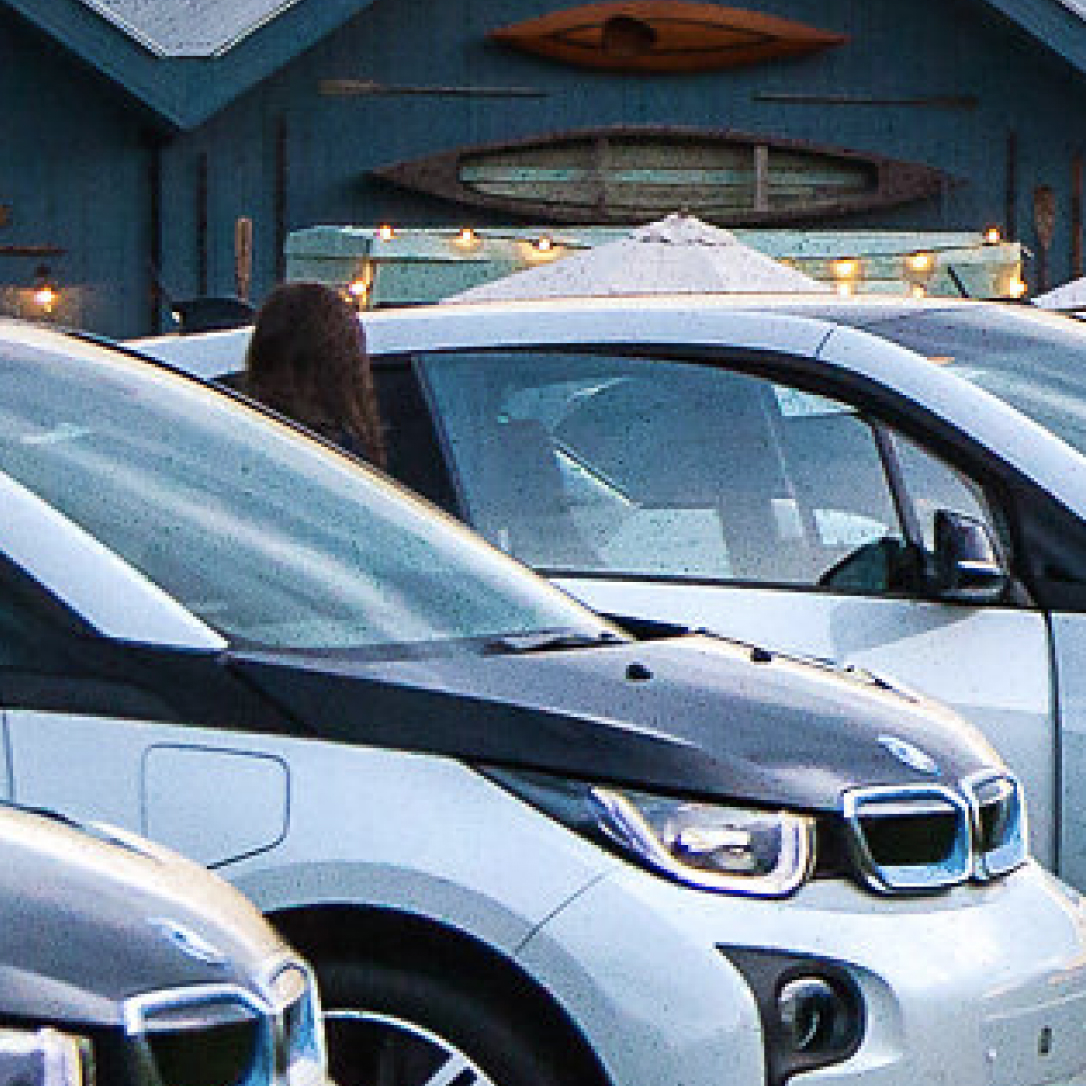 A row of BMW cars parked next to each other.