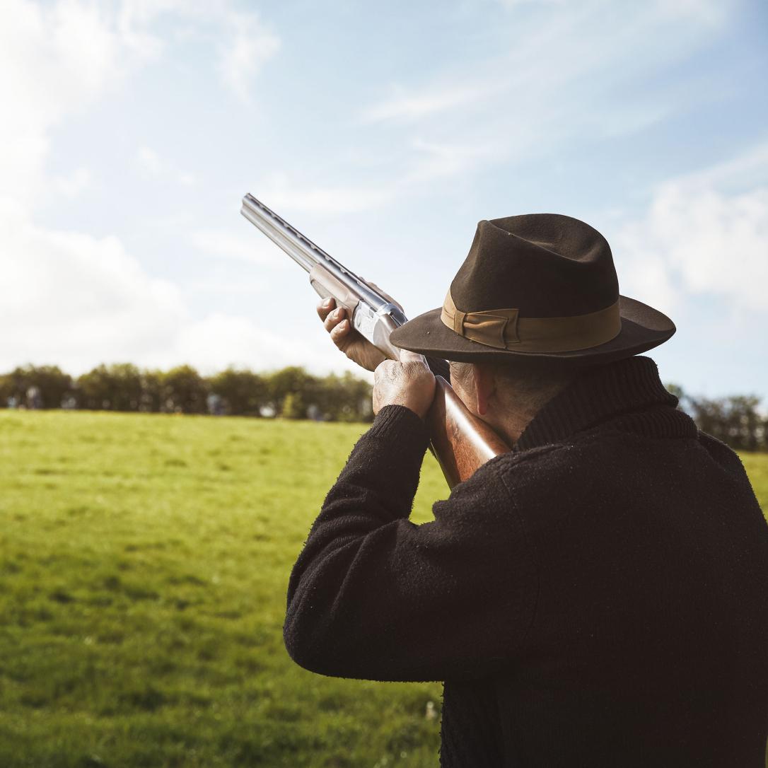 A man firing a rifle.