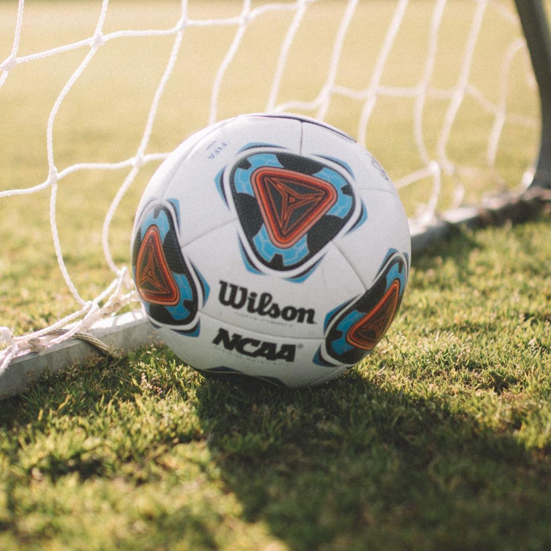 A football in a goal.