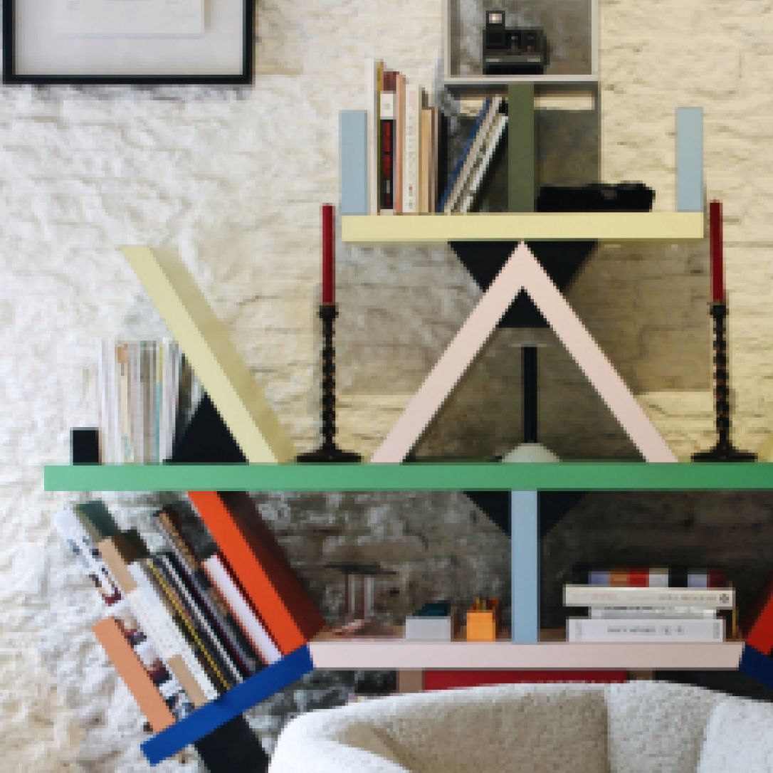 A colourful bookshelf with books on it.