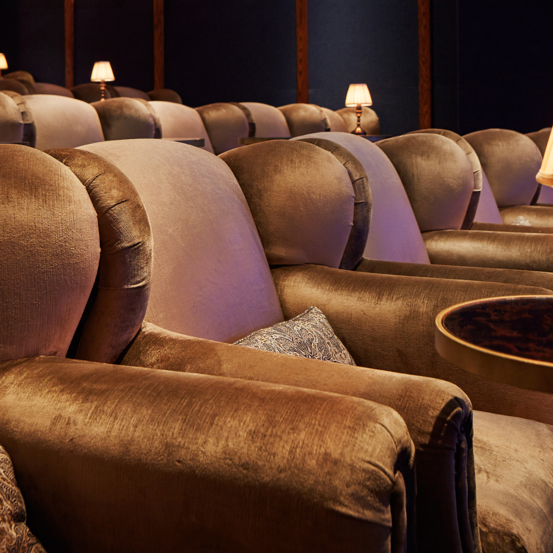 Rows of large cinema armchairs.