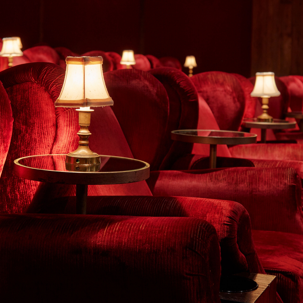 Large red armchairs in a cinema.