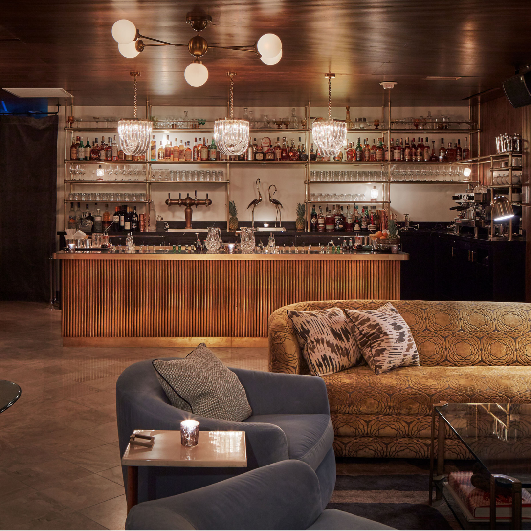 A bar a plush furnishings.