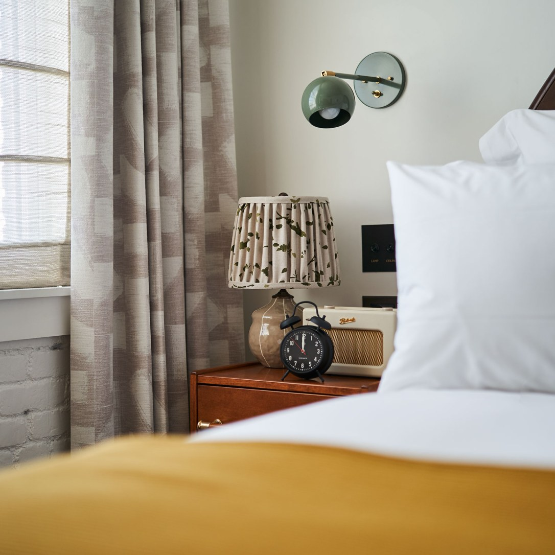 A detail of a bedrooms and bedside table.