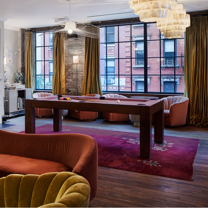 An interior with sofas and a pool table.