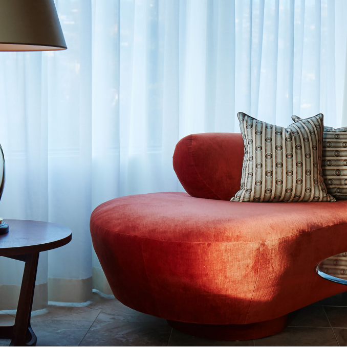 A red sofa and a floor lamp.