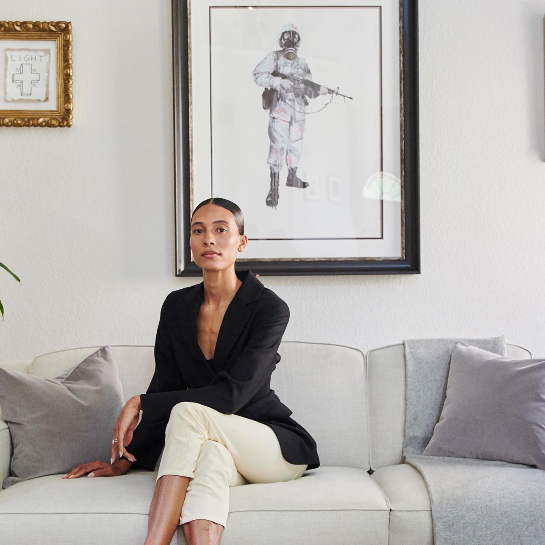 woman sat legs crossed on sofa