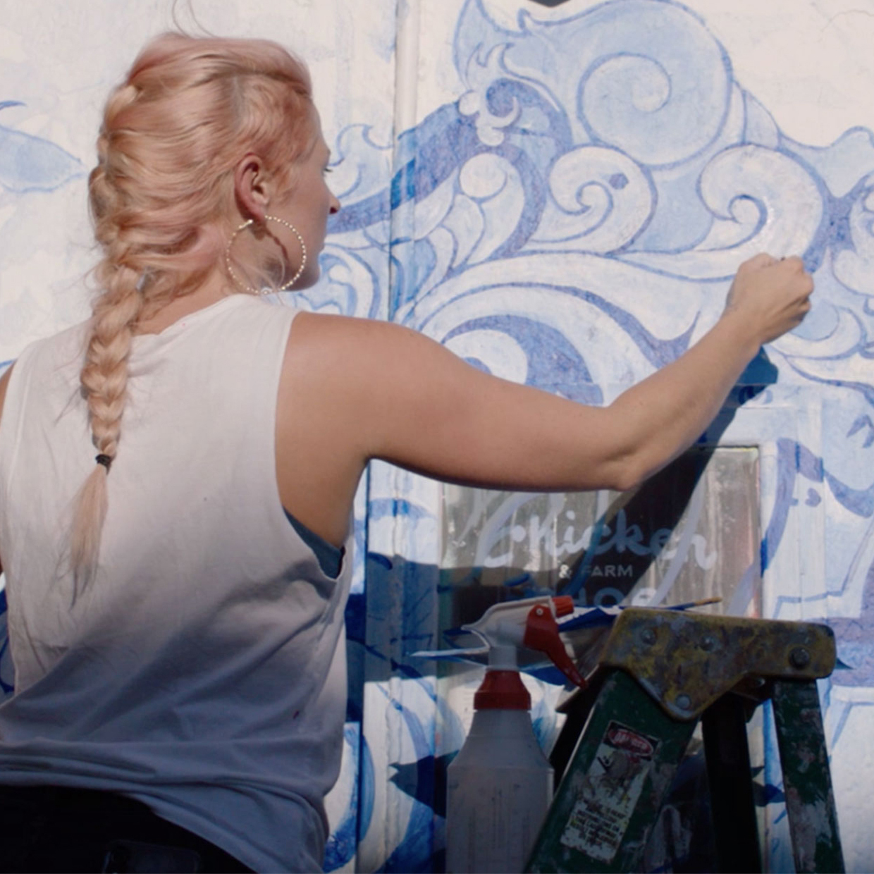 woman painting mural