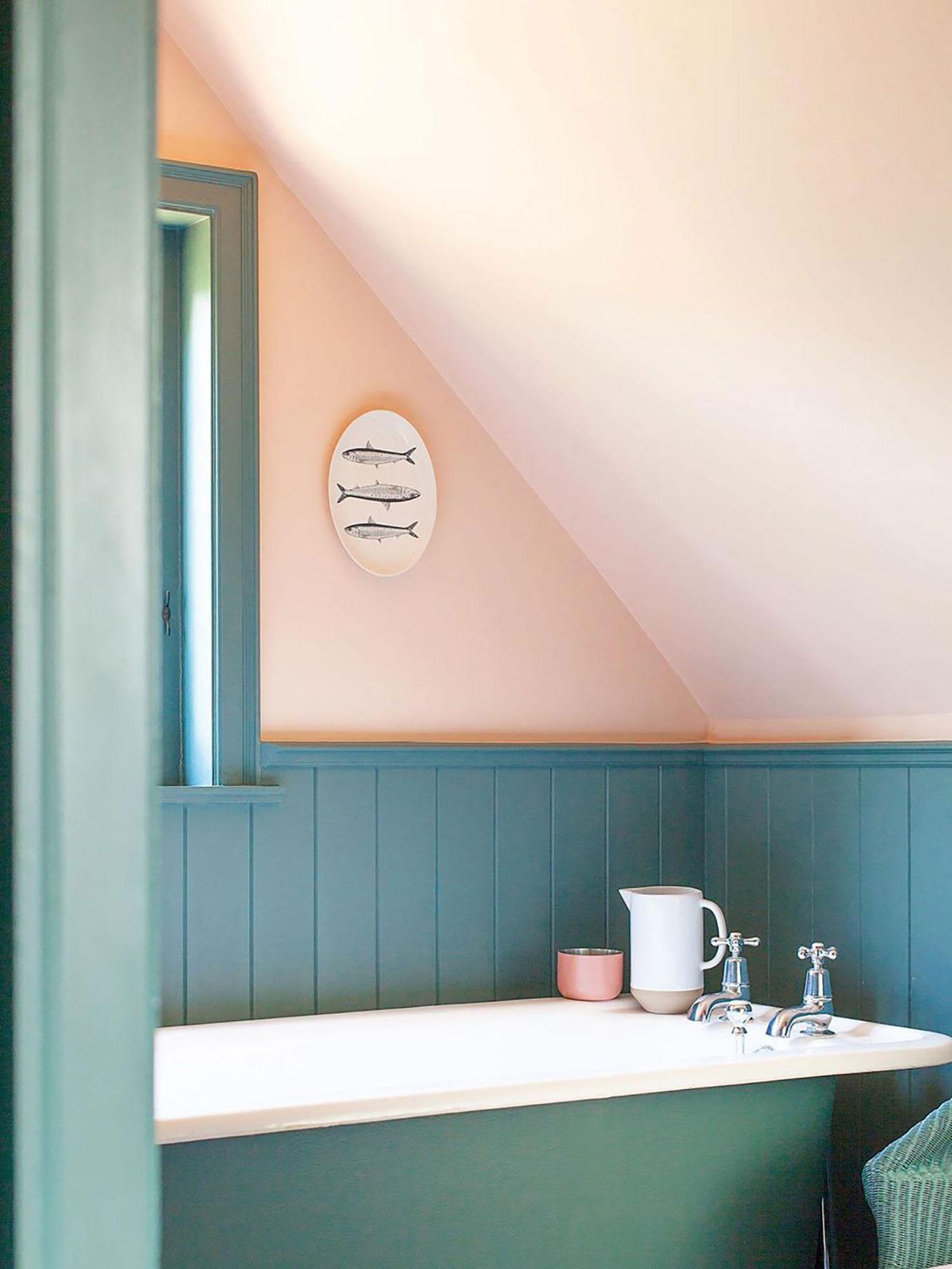 A blue an pink bathroom.