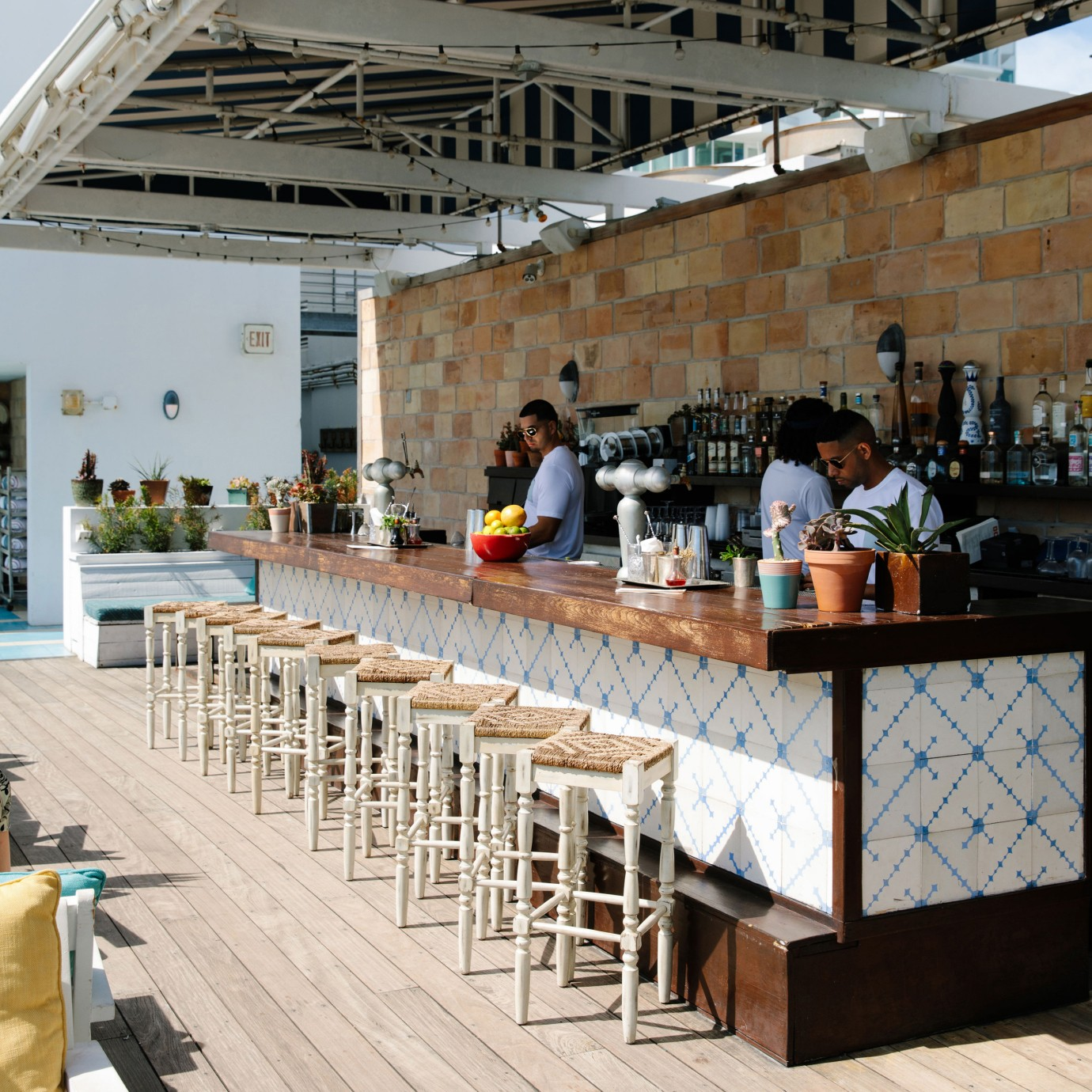 A outdoor bar with two barman.